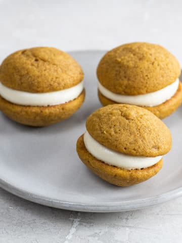 mini pumpkin whoopie pies on a small plate