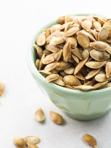roasted savory pumpkin seeds in a small bowl
