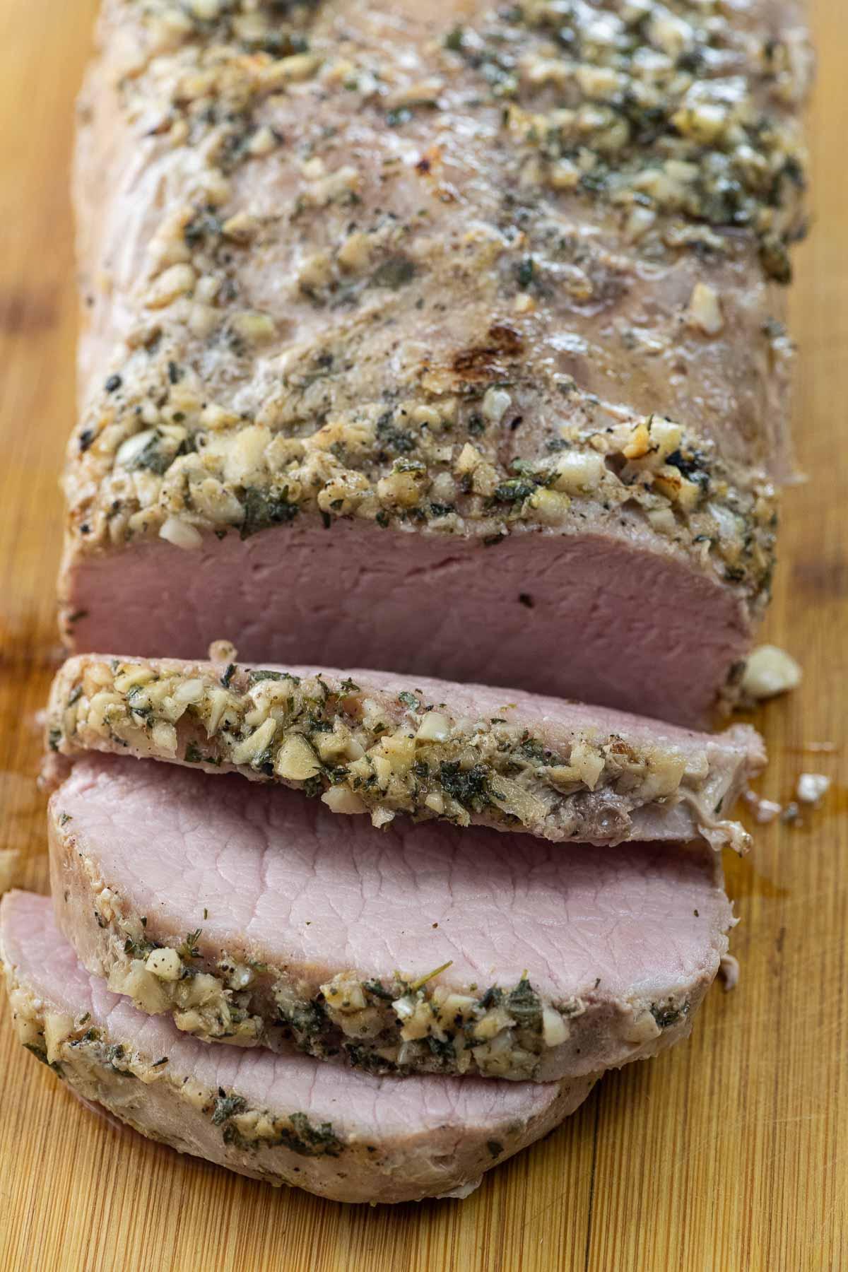sous vide pork roast on a carving board